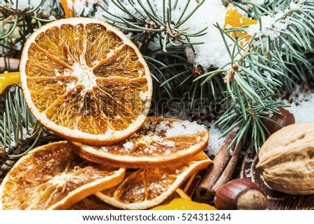 dried oranges with nuts for the Christmas holiday. Focus on the orange slices
