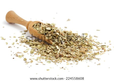 Dried oregano in a wooden spoon - stock photo