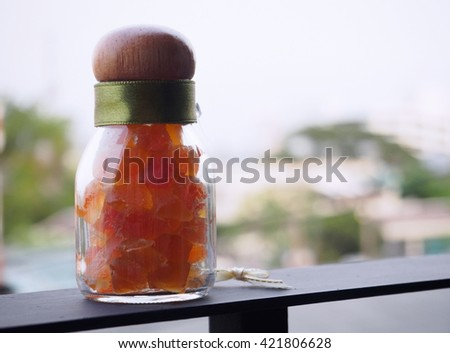 Dried papaya in a bottle - stock photo
