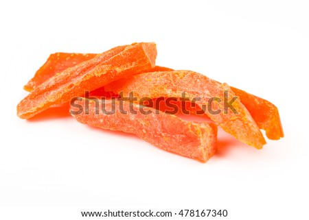 Dried papaya strips isolated on white background