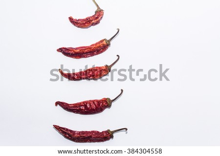 Dried paprika pods on a white background