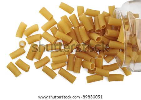 Dried pasta in a glass jar on white background - stock photo