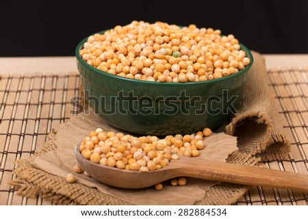 Dried peas in a green bowl - stock photo