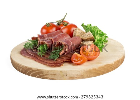 Dried pig meat slices isolated