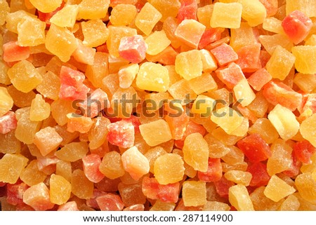 Dried pineapple and papaya pieces as an abstract background texture - stock photo
