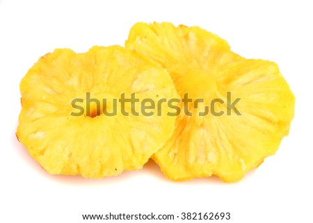 Dried pineapple slices isolated on white background