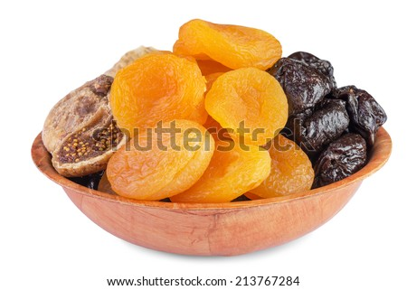 Dried pitted fruits in wooden bowl isolated on  white background - stock photo