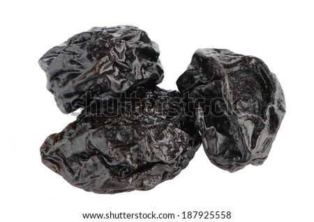 Dried plum fruits - prunes isolated on white background. - stock photo