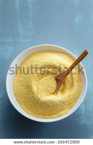 Dried polenta in white bowl - stock photo