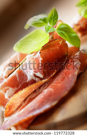 Dried pork collar salami ham with herbs - stock photo