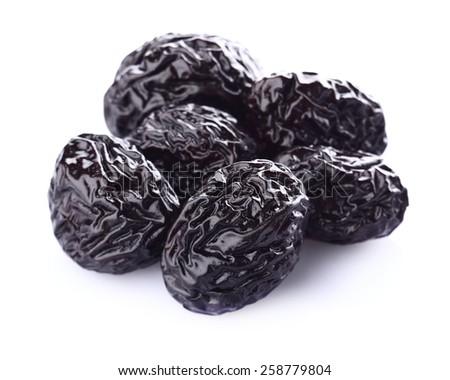 Dried prune in closeup - stock photo