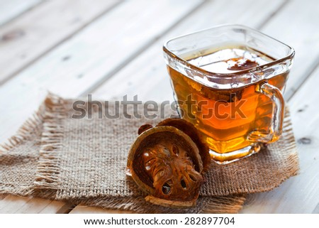 Dried quince and Quince water in glass on wooden table,Healthy drinks ,thai herb. - stock photo
