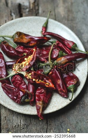 dried red chili peppers on dark background - stock photo
