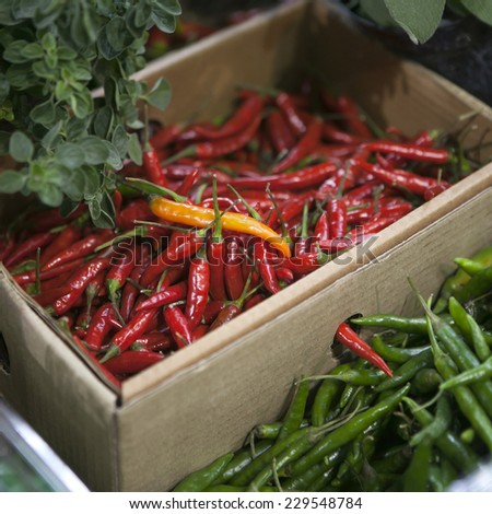 Dried red chilly PEPPER in box , food ingredient - stock photo