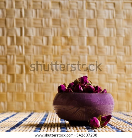 Dried rose bud, which are used for making tea. Selective focus. - stock photo