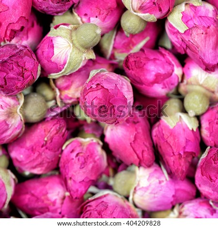 Dried rose flowers texture background closeup. Rose tea - dried rosebuds flowers texture closeup. Dry roses petals for Asian tea and spices. Copyspace for element or background. - stock photo