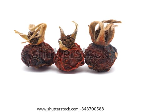 dried rose hips on a white background