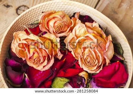 Dried rose petals: for tea, alternative medicine, pot-pourri. - stock photo