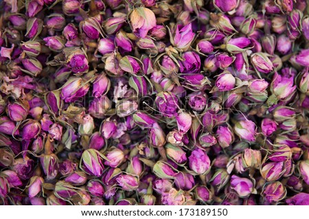 Dried rosebuds background texture closeup. violet rosebud macro close up of heap. - stock photo