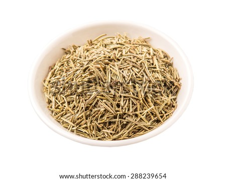 Dried rosemary herb leaves in white bowl white background