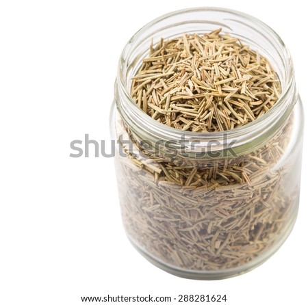 Dried rosemary herbs in a mason jar over white background - stock photo