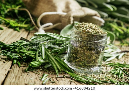 Dried rosemary in a glass jar, branches of fresh rosemary, vintage ...