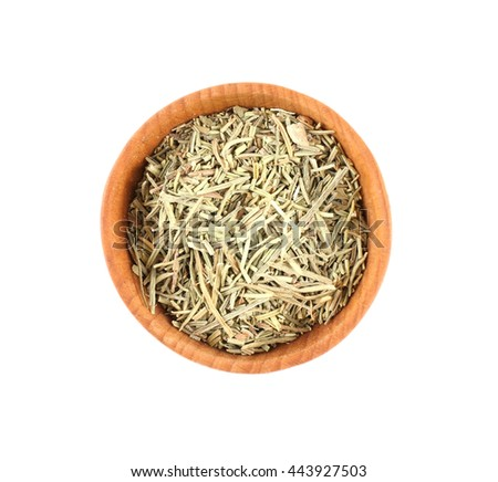 Dried rosemary in small wooden bowl isolated on white