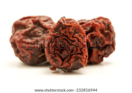 Dried rowan berries on a white background  - stock photo
