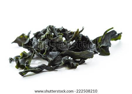dried seaweed known as pacific wakaame isolated on a white background - stock photo