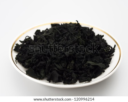 dried seaweed on a plate isolated white background - stock photo