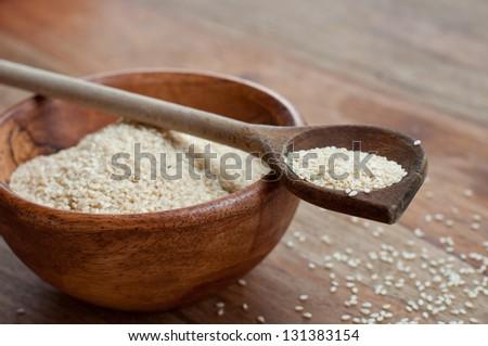 Dried sesame on spoon - stock photo