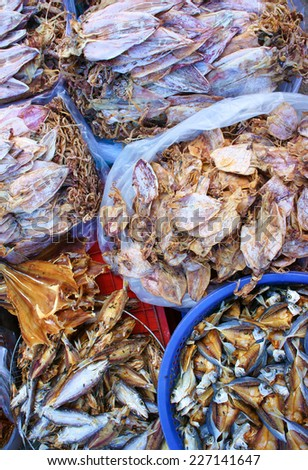 Dried shredded squid, seafood product, made from squid or cuttlefish, commonly found in coastal Asian, show at Vietnam open air market, is popular street snack