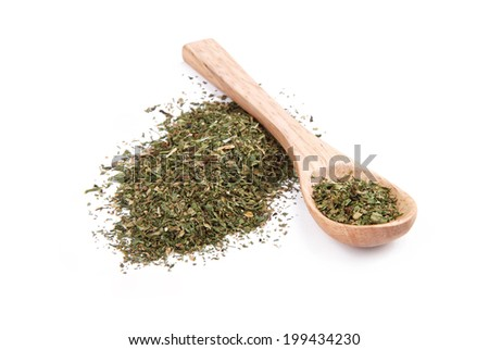 Dried spices herbs in wooden spoon - stock photo