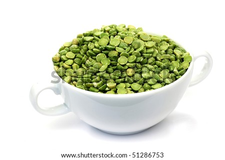 dried split peas in a white bowl on a white background - stock photo