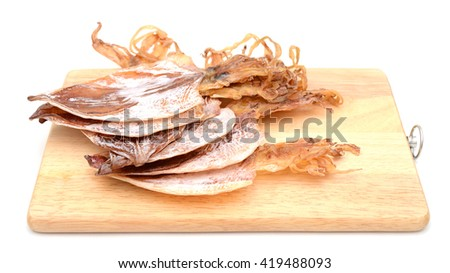 dried squids on cutting board isolated on white