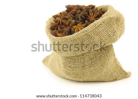 dried star anise  (Illicium verum) in a burlap bag on a white background