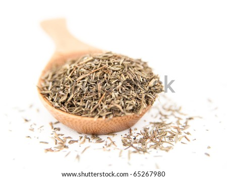 Dried Thyme Spice in Wooden Spoon on White Background - stock photo