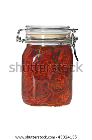 Dried tomatoes in olive oil in glass jar isolated on white.