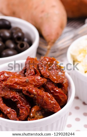 Dried tomatoes in white porcelain bowl