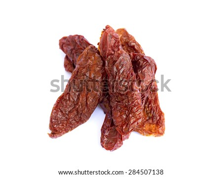 dried tomatoes on a white background - stock photo