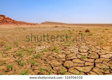 dried-up and cracked soil in the valley to North Africa Morocco