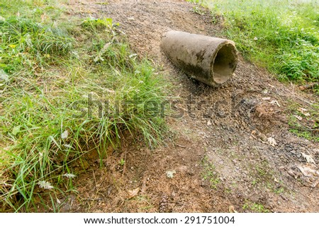 Dried Up Drainage Pipe - stock photo
