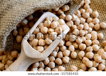 dried white chickpeas ceci on sack close up - stock photo