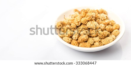 Dried white mulberry in white bowl over white background