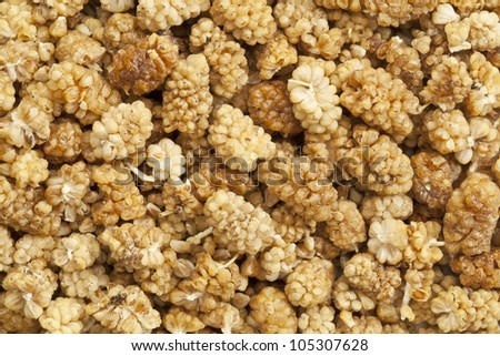 dried white mullberry berries background and texture