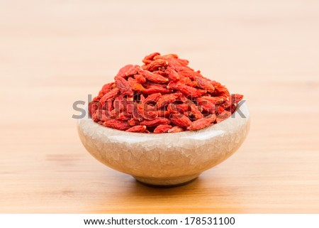 dried wolfberry fruit in bowl - stock photo