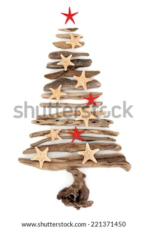 Driftwood christmas tree abstract with starfish over white background - stock photo