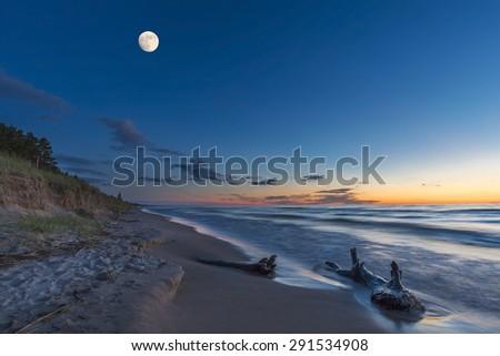 Driftwood on a Lake Huron Beach at Twilight - Grand Bend, Ontario, Canada - stock photo