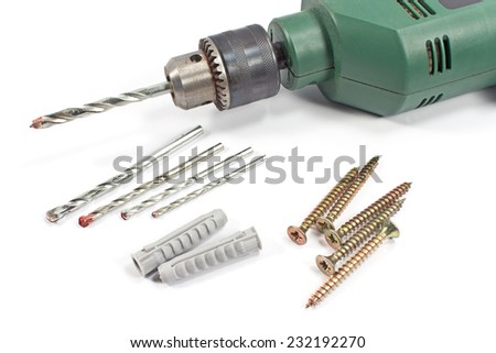 Drill and set of drill bits with screws on white