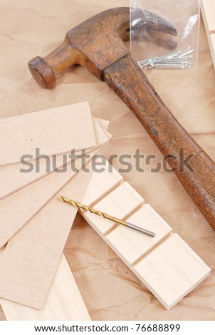 Drill Bit on Wood Pieces with Hammer